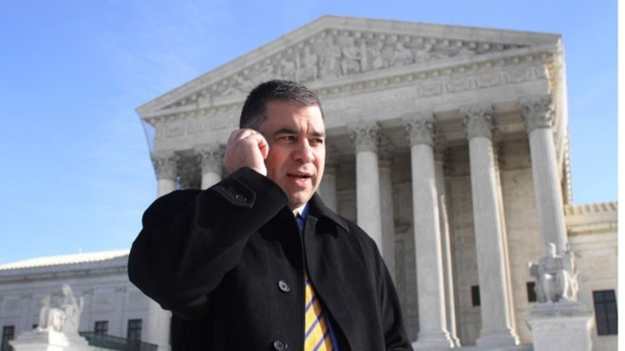 FILE: Jan. 21, 2010: Citizens United President David Bossie talks on his cell phone outside the Supreme Court, in Washington, D.C.