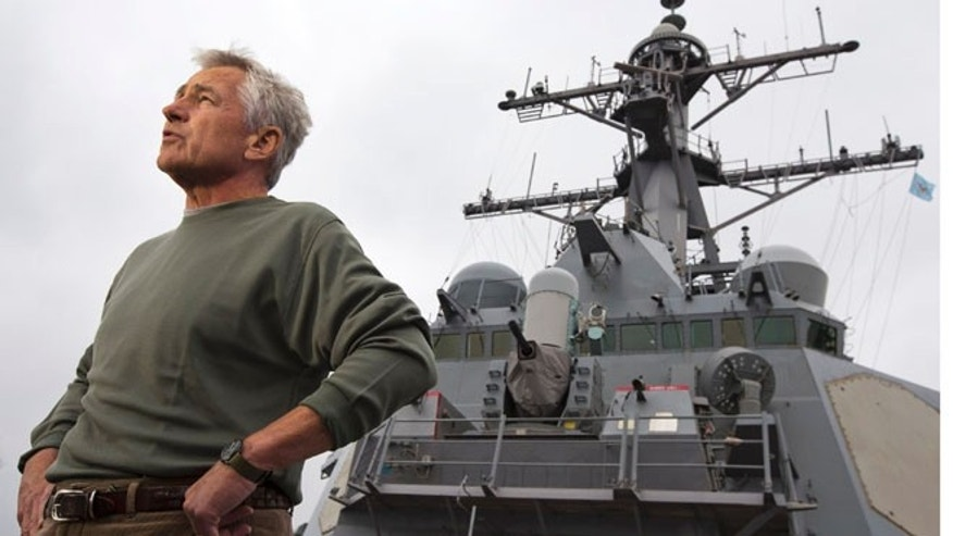 FILE: Oct. 4, 2013: Defense Secretary Chuck Hagel aboard the USS Stethem DDG 63 at Fleet Activities Yokosuka, a U.S. Naval base in Yokosuka, outside of Tokyo.