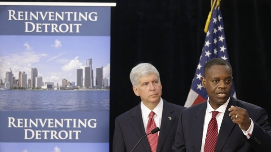 FILE - In this July 19, 2013, file photo, state-appointed emergency manager Kevyn Orr, right, and Michigan Gov. Rick Snyder, address reporters during a news conference in Detroit after Orr asked a federal judge for bankruptcy protection. (AP Photo)