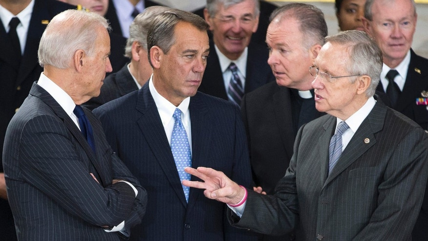 Vice President Joseph Biden, Speaker of the House John Boehner and Senate Majority Leader Harry Reid in the U.S. Capitol Rotunda in Washington on December 20, 2012.