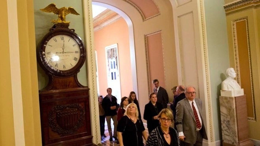 Oct. 10, 2013: People look toward the Ohio Clock outside the Senate Chamber on Capitol Hill Thursday in Washington.