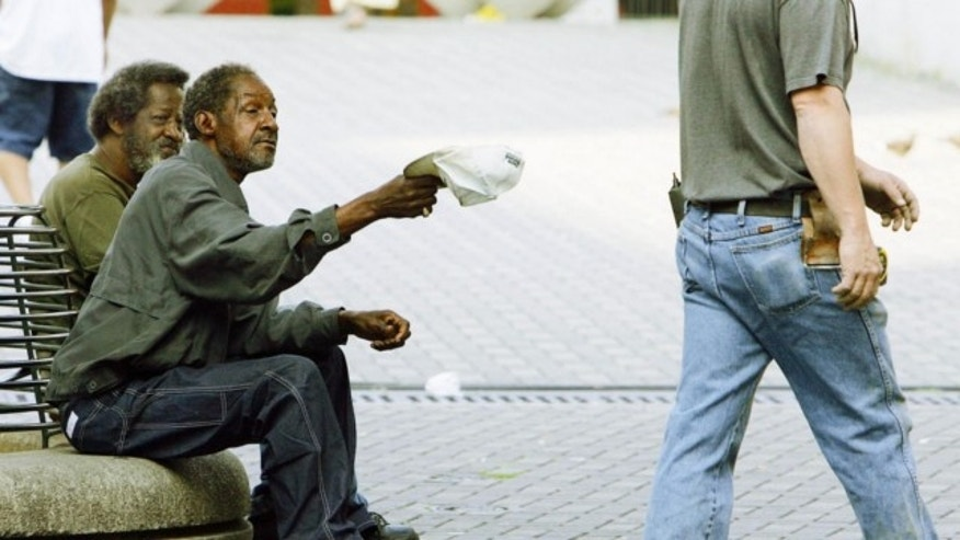 FILE: A law passed in Middle Township will require panhandleers to get permits in an attempt to combat aggressive panhandling and to limit the areas where they can ask for money.