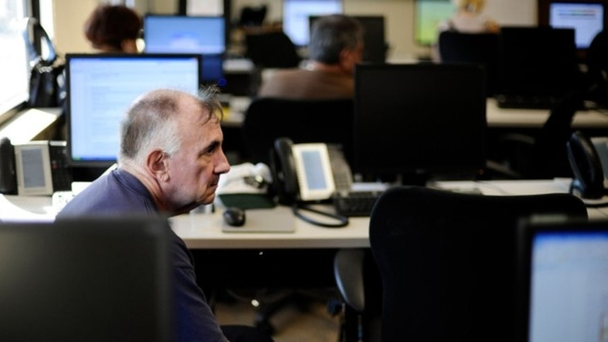Oct. 1, 2013: Bob Ettinger sits at a frozen computer station while attempting to enroll in the nation's new health insurance system at the Community Health Center in New Britain, Conn.