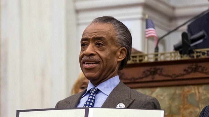 FILE: Oct. 10, 2013: The Rev. Al Sharpton receiving a citation from the Philadelphia City Council,  at City Hall in Philadelphia, Pa.