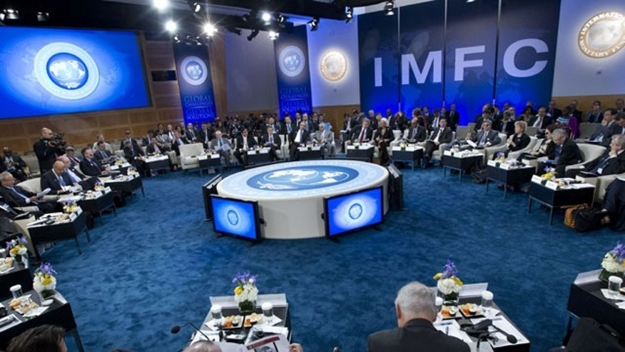 October 12, 2013: The IMFC meeting begins during the World Bank/IMF Annual Meetings at IMF headquarters Saturday in Washington. World finance officials prepared to wrap up three days of meetings in Washington, where fretting about the risk of an unprecedented U.S. debt default overshadowed myriad worries about a shaky global economic recovery. ( AP Photo)