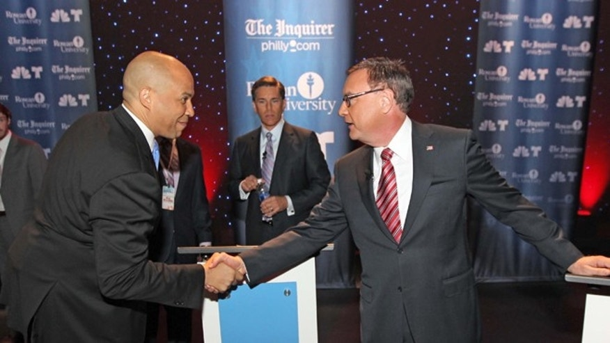 FILE:  Oct. 9, 2013.: Senate candidates Cory Booker, left, and Steve Lonegan shake hands before a debate at Rowan University, Glassboro, N.J.