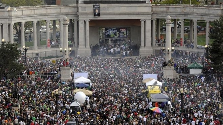 FILE: This April 20, 2012 file photo shows a cloud of smoke covering the crowd at the Denver 420 rally in Civic Center Park.