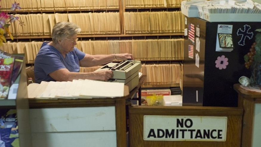 July 14, 2013: An employee is shown working in the reception and office area of a clinic in Altamont, Tenn.