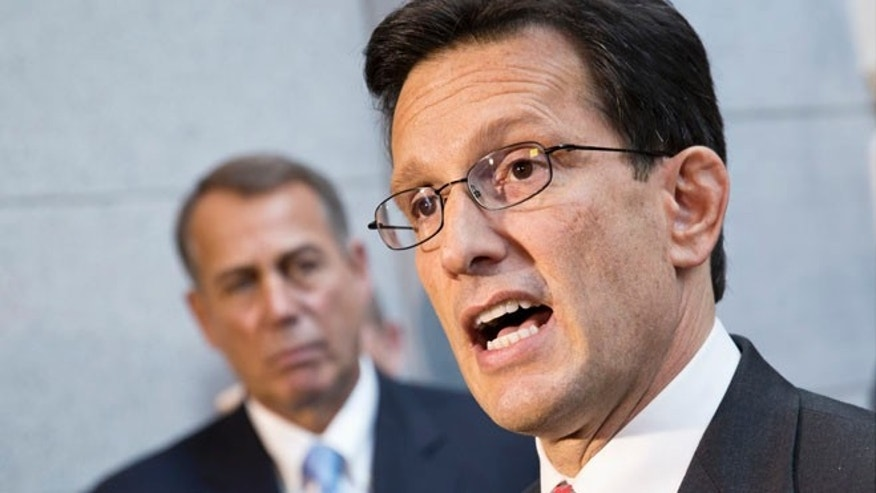 Oct. 15, 2013 - House Majority Leader Eric Cantor, R-Va., with House GOP leaders, speaks with reporters following a Republican strategy session, at the Capitol in Washington on Tuesday. At left is Speaker of the House John Boehner, R-Ohio.