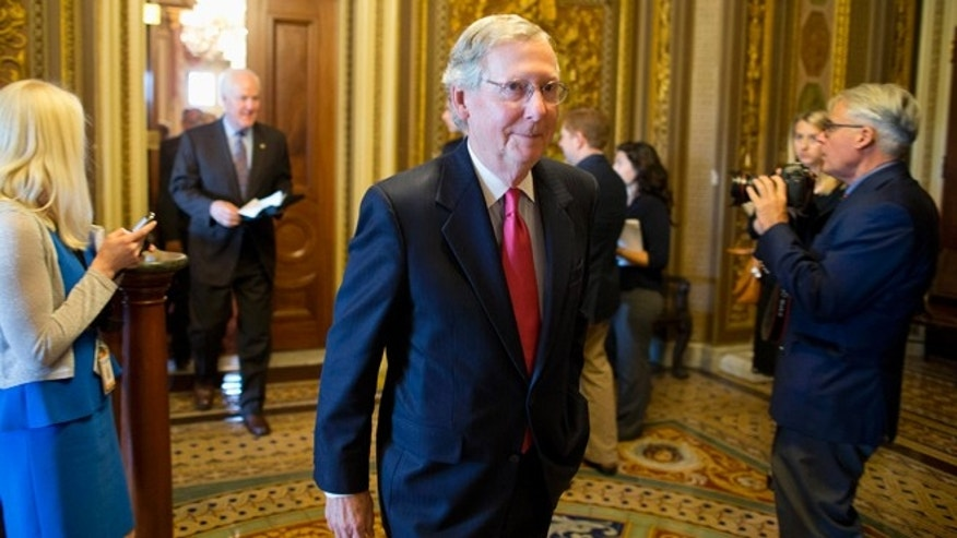 Oct. 8, 2013: Senate Minority Leader Mitch McConnell walks to the Senate floor on Capitol Hill in Washington.