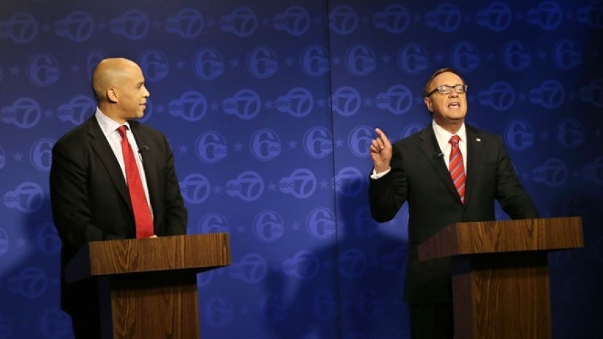Oct. 4, 2013: Cory Booker, left, looks on as Republican Steve Lonegan answers a question during their first debate of the U.S. Senate campaign in Trenton, N.J. Booker is Newark's two-term mayor.