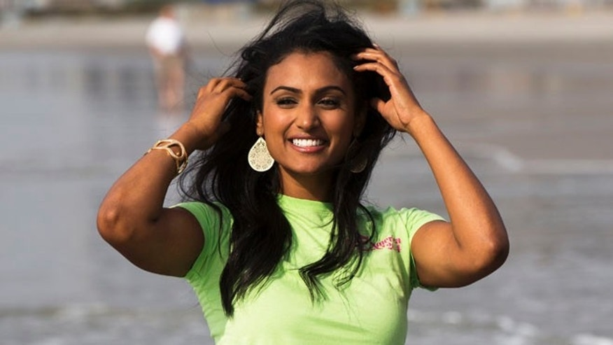 Sept. 16, 2013: Miss America 2013 Nina Davuluri poses for a photo standing in the Atlantic Ocean in Atlantic City, New Jersey.