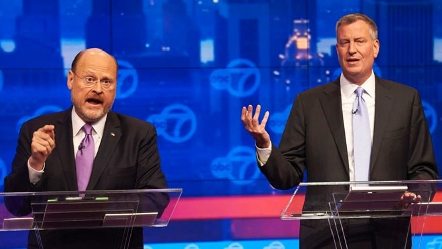 Oct. 15, 2013: New York City Republican mayoral candidate Joe Lhota, left, and Democratic mayoral candidate Bill de Blasio, participate in their first televised debate at WABC/Channel 7 studios in New York.
