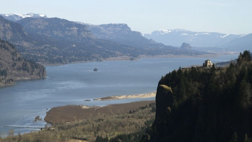 March 7, 2012: In this file photo, the Columbia River flows past the Vista House on Crown Point at right near Corbett, Ore.