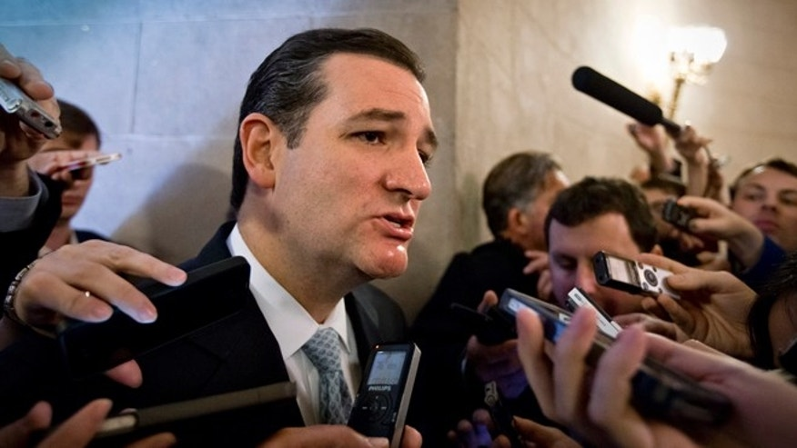 Wednesday, Oct. 16, 2013: Sen. Ted Cruz, R-Texas, speaks to reporters waiting outside a closed-door meeting of Senate Republicans, on Capitol Hill in Washington, D.C.