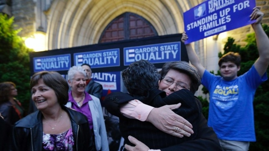 Sept. 27, 2013: Cindy Meneghin, second from right, hugs her attorney Hayley Gorenberg during a rally at Garden State Equality in Montclair, N.J., hours after a Superior Court Judge ruled that New Jersey is unconstitutionally denying federal benefits to gay couples and must allow them to marry.