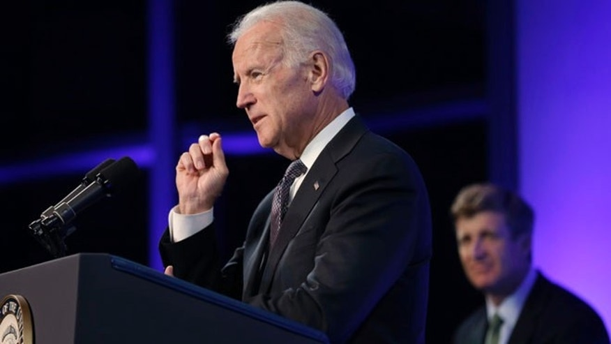 Oct. 23, 2013: Vice President Joe Biden, left, addresses an audience during a forum on mental health policies that marks the 50th anniversary of President John F. Kennedy's signing of the Community Mental Health Act at the JFK Library and Museum in Boston.