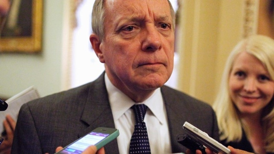 June 20, 2013: Sen.  Durbin talks with reporters near the U.S. Senate floor at the U.S. Capitol during immigration debates in Washington.