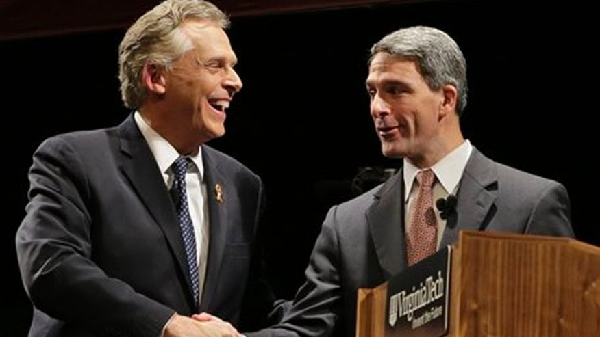Oct. 24, 2013: Democratic gubernatorial candidate, Terry McAuliffe, left, shakes the hand of  Republican challenger Virginia Attorney General Ken Cuccinelli, right, after a debate at Virginia Tech in Blacksburg, Va.