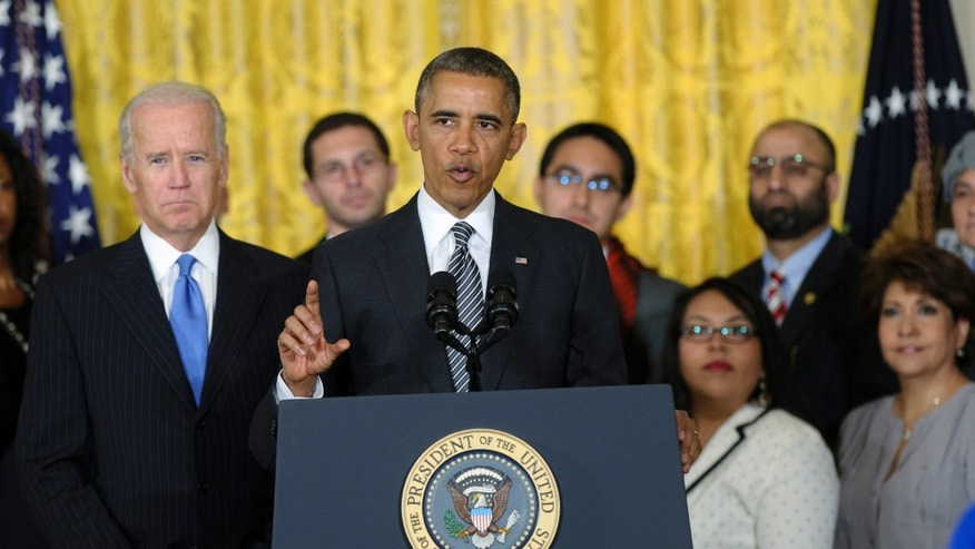 President Obama, standing next to Vice President Biden, urges Congress to take back up comprehensive immigration reform while speaking in the East Room of the White House in Washington, Thursday, Oct. 24, 2013.