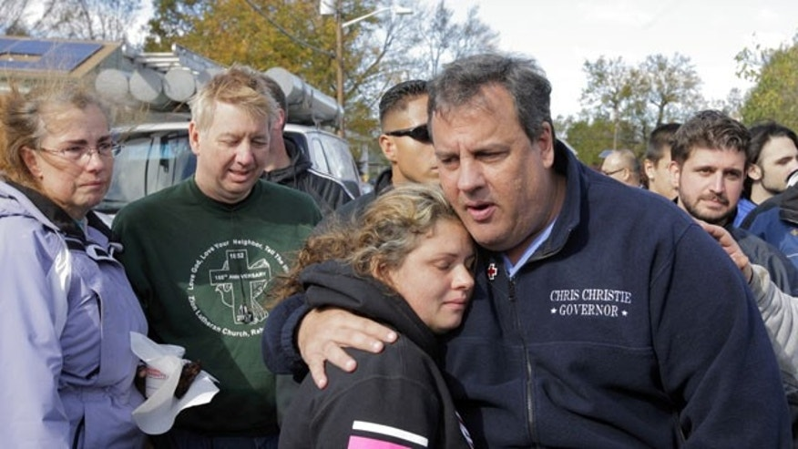 FILE - New Jersey Gov. Chris Christie comforts Kerri Berean, 33, a Chapman Street resident, in this Nov. 3, 2012 file photo taken in Little Ferry, N.J.  (AP Photo/The Star-Ledger, David Gard, POOL)