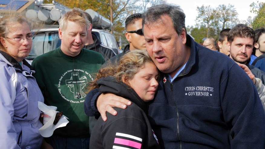 New Jersey Gov. Chris Christie comforts Kerri Berean, 33, a Chapman Street resident, in this Nov. 3, 2012 taken in Little Ferry, N.J.