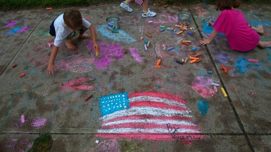 Children draw on the sidewalk during an Independence Day party in Union Beach, New Jersey July 3, 2013.