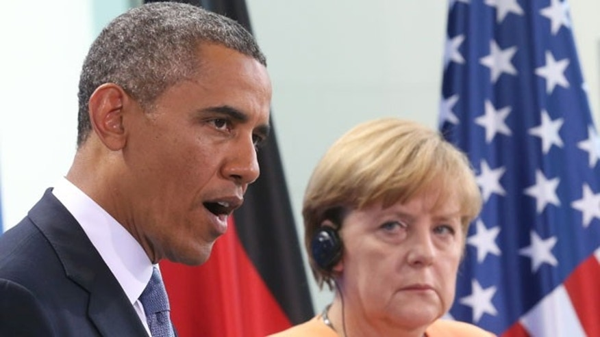 FILE - In this June 19, 2013 file picture US President Barack Obama speaks during a press conference with German Chancellor Angela Merkel, right, at the Chancellery in Berlin. (AP Photo)