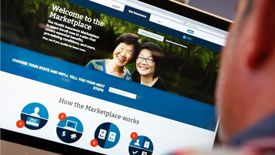 Oct. 2, 2013: A man looks over the Affordable Care Act (commonly known as Obamacare) signup page on the HealthCare.gov website in New York in this photo illustration.