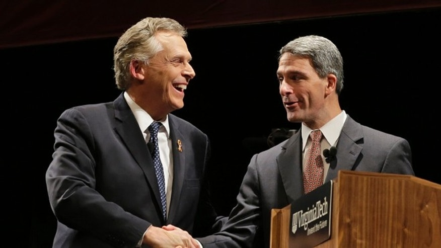 FILE: Oct. 24, 2013: Democratic gubernatorial candidate Terry McAuliffe, left, shakes hands with Republican challenger Virginia Attorney General Ken Cuccinelli at a debate at Virginia Tech in Blacksburg, Va.
