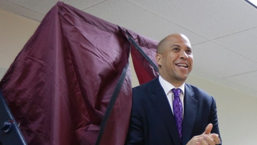 Wednesday, Oct. 16, 2013: Newark Mayor Cory Booker exits a polling booth in his race to win a Senate seat, Newark, N.J.