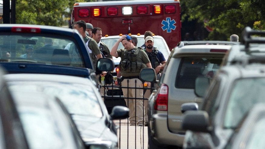 September 16, 2013: Heavily armed U.S. marshals walk from the Washington Navy Yard after a shooting by gunman Aaron Alexis.