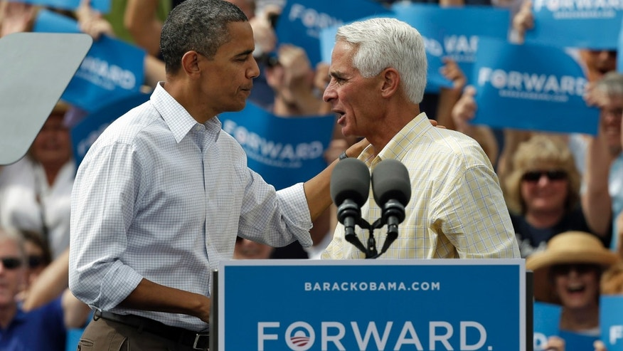 FILE - In this Saturday, Sept. 8, 2012 file photo, President Obama, left, talks with former Florida Gov. Charlie Crist at a campaign rally in Seminole, Fla.
