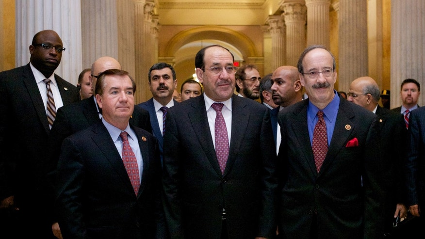 Iraqi Prime Minister Nouri al-Maliki, center, walks with the House Foreign Affairs Committee ranking Democrat Rep. Eliot Engel, D-N.Y., right, and the committee's chairman Rep. Ed Royce, R-Calif. in Washington, Wednesday, Oct. 30, 2013, before their meeting.