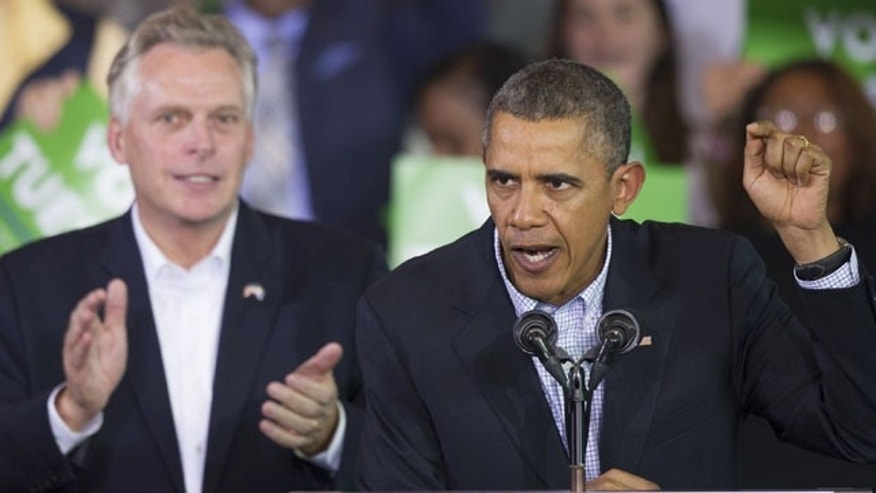 November 3, 2013: President Barack Obama speaks at a campaign rally with supporters for Virginia Democratic gubernatorial candidate Terry McAuliffe, right, at Washington Lee High School in Arlington, Va. (AP Photo/Cliff Owen)