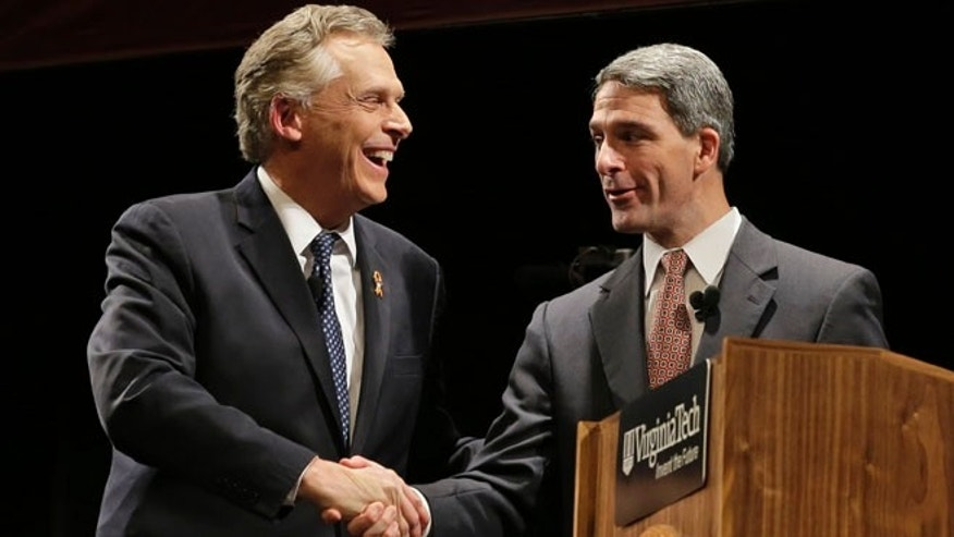 Democratic gubernatorial candidate, Terry McAuliffe and Republican challenger Virginia Attorney General Ken Cuccinelli after a debate at Virginia Tech in Blacksburg, Va., Thursday, Oct. 24, 2013.