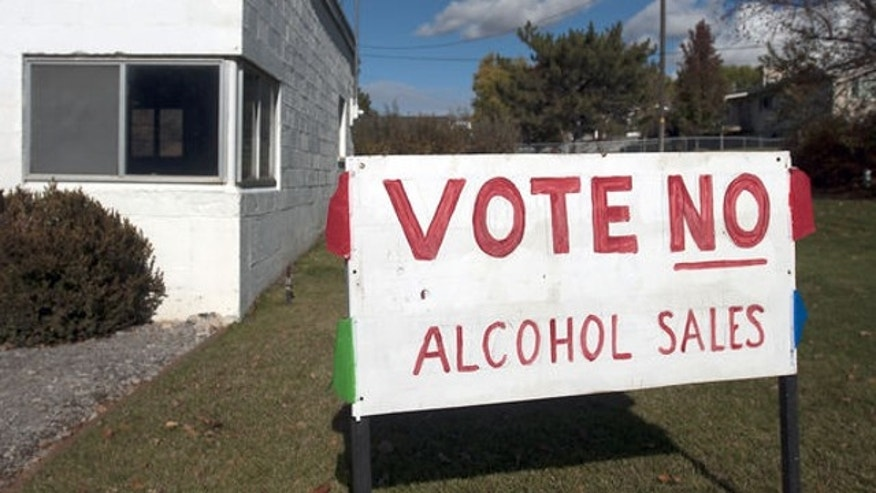 Nov. 4, 2013: A sign stands outside a business in Hyde Park, Utah, urging voters to not allow alcohol sales in the town.