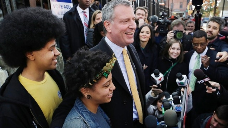 Nov. 5, 2013 : Democratic mayoral candidate Bill de Blasio embraces his daughter Chiara as he talks to the media after voting.