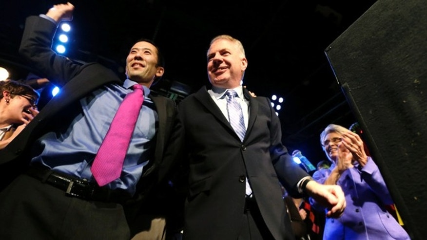 Nov. 5, 2013: Seattle mayoral candidate state Sen. Ed Murray, center, is cheered by his husband, Michael Shiosaki, left, and former Gov. Chris Gregoire at an election night party.