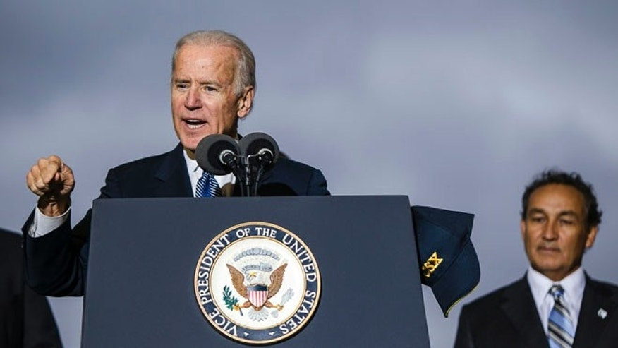 Vice President Joe Biden addresses an audience, Wednesday, Nov. 6, 2013, at the CSX Northwest Ohio Intermodal Terminal in North Baltimore, Ohio.
