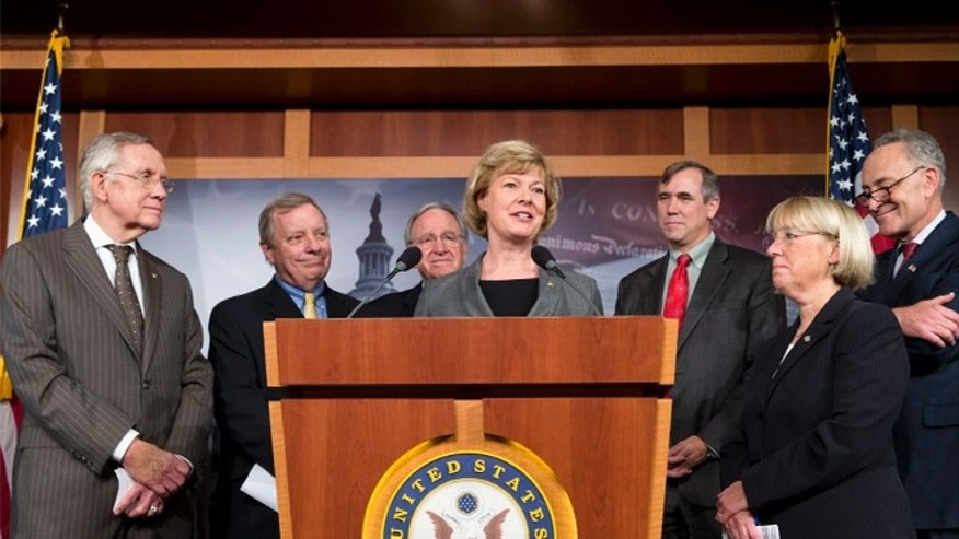 Nov. 7, 2013: Sen. Tammy Baldwin, D-Wis., center, the Senateâs first openly gay member, is surrounded by fellow Democrats just before a historic vote on legislation outlawing workplace discrimination against gay, bisexual and transgender Americans.