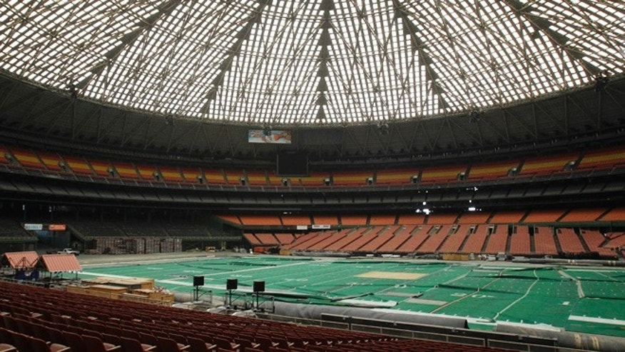 In this May 21, 2012 file photo, the Astrodome sits gathering dust and items for storage in Houston. A coalition of local and national preservation groups is taking its efforts to save the iconic but now shuttered Houston Astrodome to the streets.