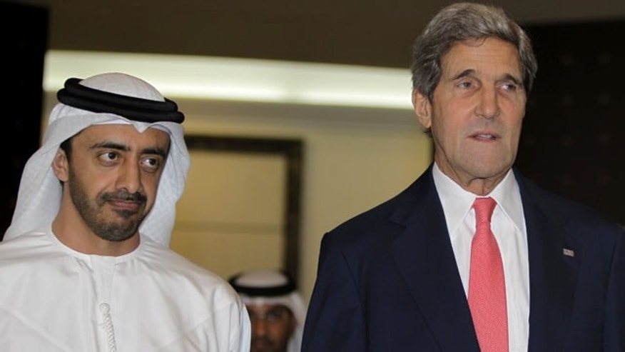 November 11, 2013: U.S. Secretary of State John Kerry, right, arrives with Sheikh Abdullah bin Zayed Al Nahyan, UAE minister of foreign affairs for a join press conference in Abu Dhabi, United Arab Emirates. (AP Photo/Kamran Jebreili)