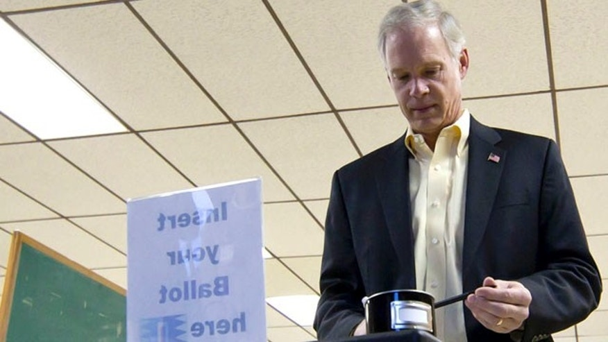 FILE: Wisconsin Republican Sen. Ron Johnson casts a ballot in Oshkosh, Wis.