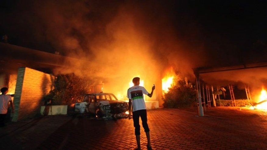 Sept. 11, 2012: The U.S. Consulate in Benghazi is seen in flames during a protest by an armed group said to have been protesting a film being produced in the United States.