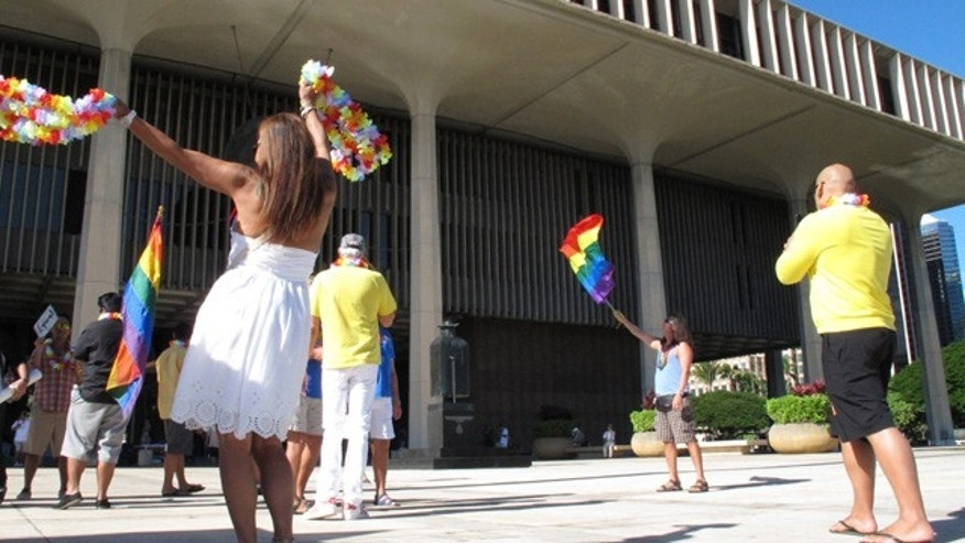 Nov. 12, 2013: Gay marriage supporters rally outside the Hawaii Capitol in Honolulu ahead of a Senate vote on whether to legalize same-sex marriage.