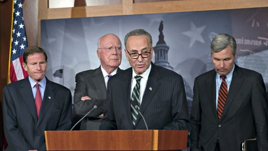 November 12, 2013: Sen. Chuck Schumer, D-N.Y., center, speaks to reporters after Senate Republicans derailed President Barack Obama's selection of Georgetown University law professor Cornelia Pillard to fill one of three vacancies on the U.S. Court of Appeals for the District of Columbia Circuit, at the Capitol in Washington as from left, Sen. Richard Blumenthal, D-Conn., Senate Judiciary Committee Chairman Patrick Leahy, D-Vt., amd Sen. Sheldon Whitehouse, D-R.I., listen.