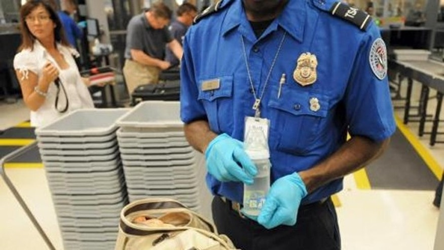 FILE: A Transportation Security Administration agent inspecting bags at Hartsfield–Jackson Atlanta International Airport.