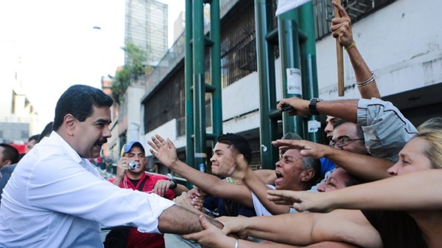 President Maduro during a transport workers rally in Caracas, Venezuela, Tuesday, Nov. 12, 2013.