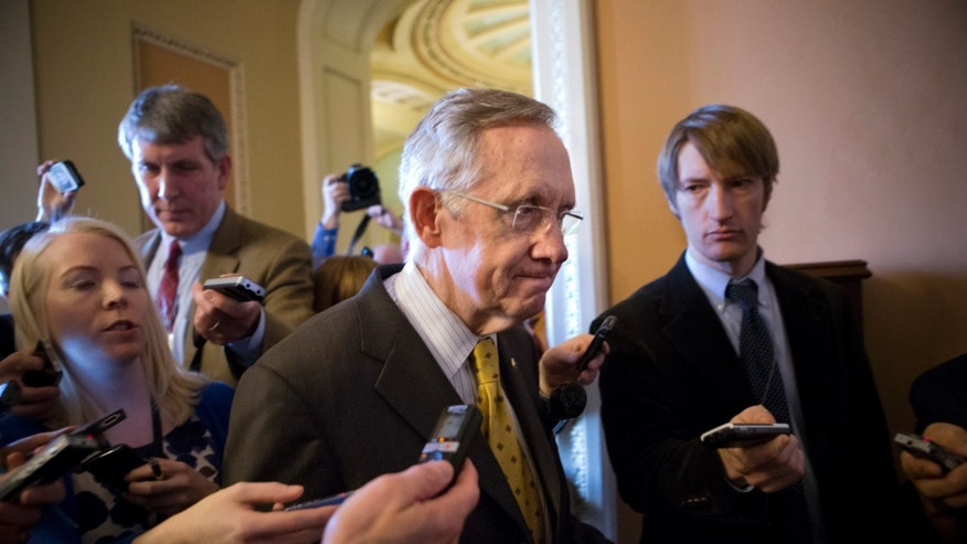 FILE: Dec. 30, 2012: Senate Majority Leader Harry Reid walks to meeting on Capitol Hill, in Washington, D.C.